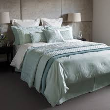 Blue And White Comforter White Bedding With Blue Pillows And Blanket Grey Carpet Floor Grey