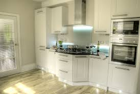 contemporary white kitchen with shaker cabinets to refine a kitchen