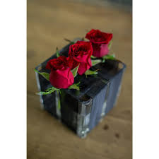 glass roses in glass cube