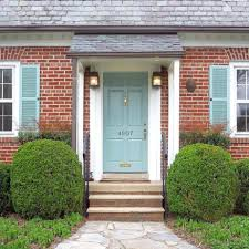 blue front door red brick house green brown with black best color