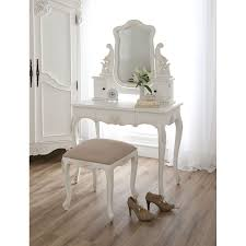 carved white wooden make up table and white lily on white vase