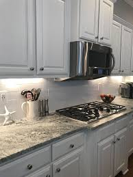 what color countertops with white cabinets and gray walls granite viscount white white subway tile cabinets bm