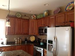 Top Of Kitchen Cabinet Decor Ideas Valuable Top Of Cabinet Decor On Cabinets Kitchen Decorating And