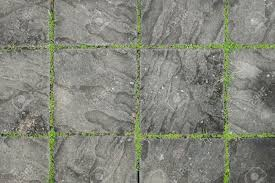 exposed concrete block floor with grass stock photo picture and