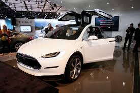 tesla electric car tesla delivers model x electric suv to take on luxury carmakers