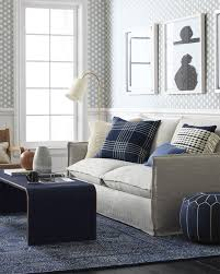 light blue area rugs white fabric sofa covers flower vase chrome