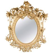french rococo oval mirror with 24 karat gold gilt and foliage
