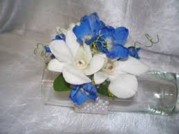 orchid wrist corsage white orchids and delphinium wrist corsage in johnsbury vt