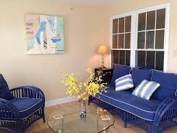 impressive small sunroom design with blue chair and cream wall