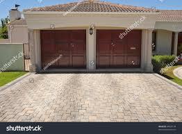 Garage House by Wooden Brown Double Garage Doors Big Stock Photo 44523130