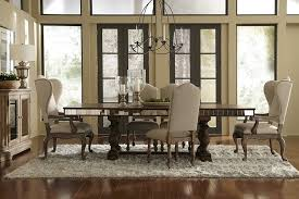 dining room wingback dining chairs with modern chandelier and