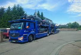 blue nissan truck transportas beljana