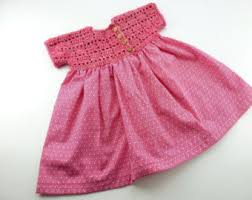 vintage inspired hand knitted baby dress in darkgrey with