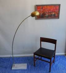 large brass arc standing lamp with marble base modern floor