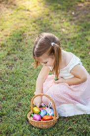 easter egg hunt baskets image of up of girl taking coloured easter eggs out of
