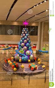 angry bird on ufo sphere christmas tree editorial stock image