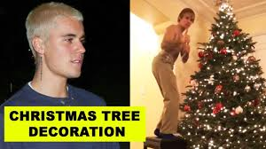 justin bieber decorating special tree for selena
