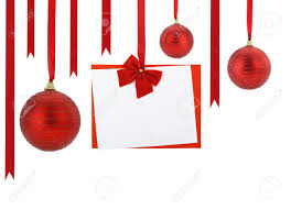 christmas card and christmas balls hanging on red ribbons stock