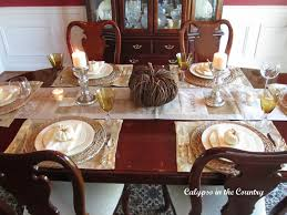 festive fall table setting with white pumpkins calypso in the