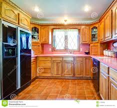 Kitchens With Wood Cabinets Farmhouse Kitchen Room With Wood Cabinets And Pink Backsplash