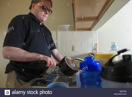 What Is Congenital Blindness Man With Congenital Blindness Washing Dishes In His Kitchen Stock