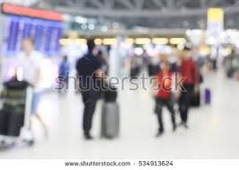 free blurred of movement crowd people walking to the airport gate