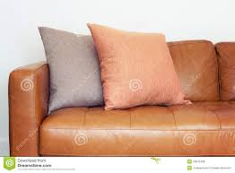 Light Brown Leather Sofa Close Up Of Tan Leather Sofa With Linen Cushions Stock Photo