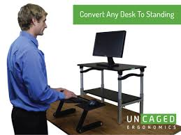 lift standing desk conversion stand up desk at uncagedergonomics