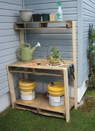 reclaimed wood outdoor potting bench with storage and shelf in the