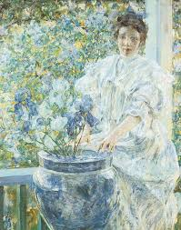 woman with a vase of irises painting by robert reid