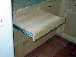installing pull out drawers in kitchen cabinets installing a pull out cutting board good idea or bad idea