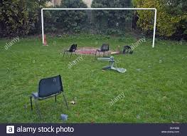 abandoned plastic chairs on football pitch glynn northern