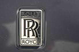 rolls royce badge saying goodbye to the rolls royce phantom coupe