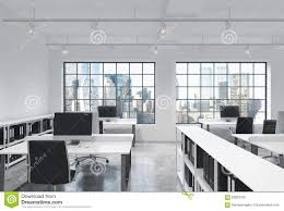 workplaces in a bright modern loft open space office tables are