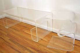 adair clear acrylic waterfall coffee table with shelf on hardwood