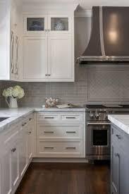 off white kitchen with grey quartz countertop the surrounding