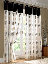 white fabric curtains with black and cream curving pattern also