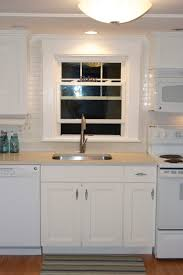 endearing wood cabinet set in kitchen with white fired ceramic