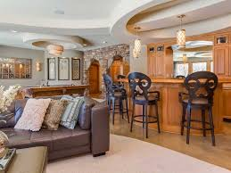 luxury basement family room design ideas with leather couch and
