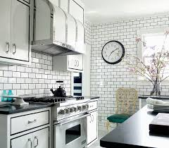 glass subway tiles kitchen grey soft leather sofa dark countertops