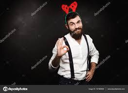 man in fake deer horns showing okay over black background u2014 stock