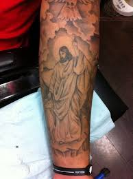jesus with clouds on forearm