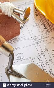 selection of builders tools on house plans stock photo royalty