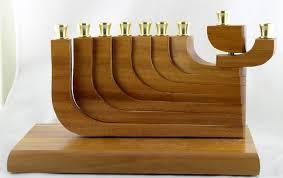 wooden menorah naturally wood mahagony kinetic menorah naw14 105 00 cbl
