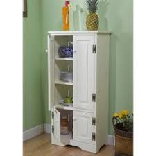 a built in microwave is located in the center of a tall pantry