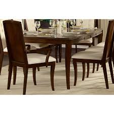 dining room in walnut hardwood with upholstered chairs embroidered