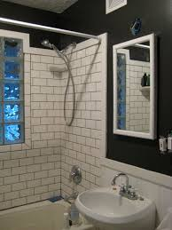 bathroom beadboard on walls with subway tile and glass block