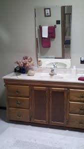 How To Mount Bathroom Mirror by How To Put A Mirror On An Angled Wall Over A Bathroom Sink Vanity