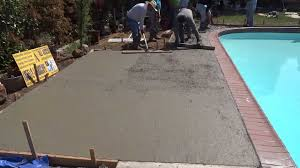 laying pavers over concrete patio concrete contractor installing patio around swimming pool all