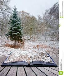 creative concept winter landscape magic book stock photo image